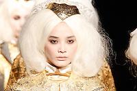 Li Wei walks the runway wearing Thom Browne Fall 2014 Collection, <br /> Thom Browne (Designer)<br /> Jimmy Paul (Hair Stylist)<br /> Sil Bruinsma (Makeup Artist)<br /> Edward Kim (Casting Director)<br /> Julie Kandalec (Manicurist)