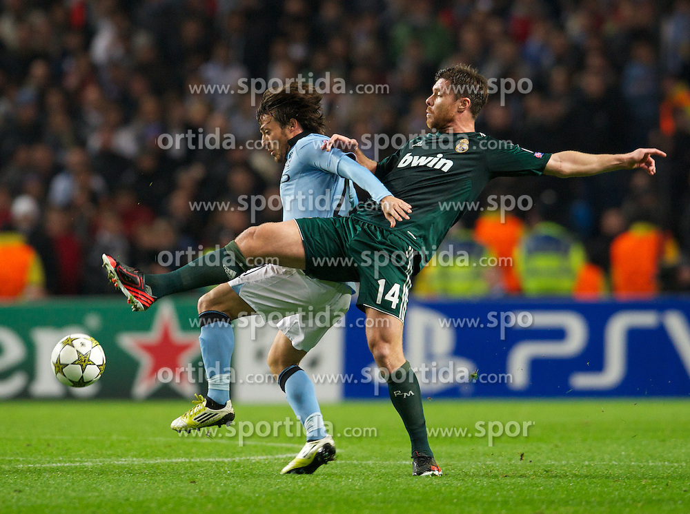 21.11.2012, Etihad Stadium, Manchester, ENG, UEFA Champions League, Manchester City vs Real Madrid, Gruppe D, im Bild Manchester City's David Silva in action against Real Madird CF's Xabi Alonso during UEFA Champions League group D match between Manchester City and Real Madrid CF at the Etihad Stadium, Manchester, Great Britain on 2012/11/21. EXPA Pictures © 2012, PhotoCredit: EXPA/ Propagandaphoto/ David Rawcliffe..***** ATTENTION - OUT OF ENG, GBR, UK *****