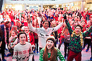Dancers as they attempt to break the Guinness World Record for the most people wearing Christmas jumpers in one place at Westfield London, W12, on Christmas Jumper Day December 13, 2013. Donate £1 to Save the Children at www.christmasjumperday.org