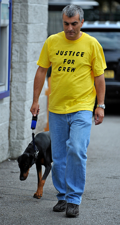 KEMPTON RACECOURSE. SURREY. Members of Unite and BA crew leave a union meeting at Kempton Racecoure in Surrey on the 6th September 2010. Union members were asked to wear the colour yellow and a decision was taken to ask the TUC for a Ballot calling for strike action for christmas. 06 SEPT 2010. STEPHEN SIMPSON ..