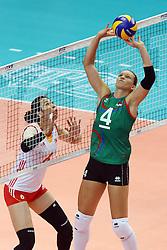 Azerbaijan Kseniya Kovalenko sets a ball