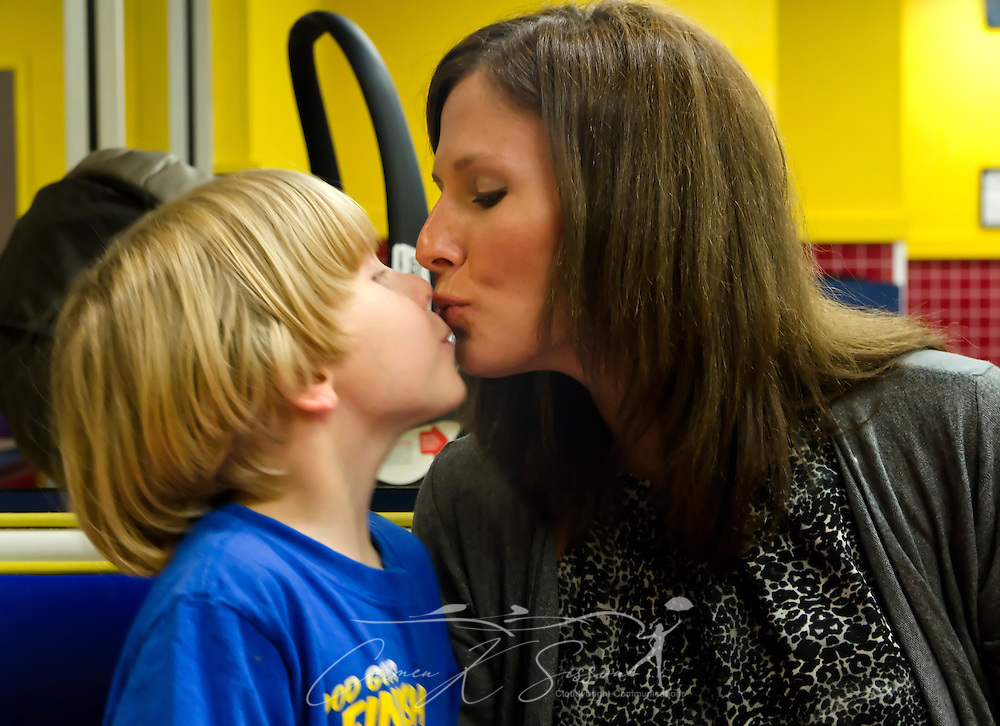 Elisha Perrigin, who has Asperger Syndrome, a form of autism, kisses his mother, Ashley Birckbichler, April 19, 2012, at McDonald's in Columbus, Miss. (Photo by Carmen K. Sisson/Cloudybright)