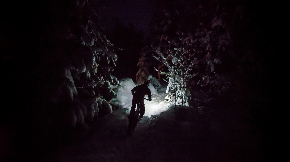 Nighttime fat bike ride on the North Snow Bike Route of the Noquemanon Trails Network in Marquette, Michigan.