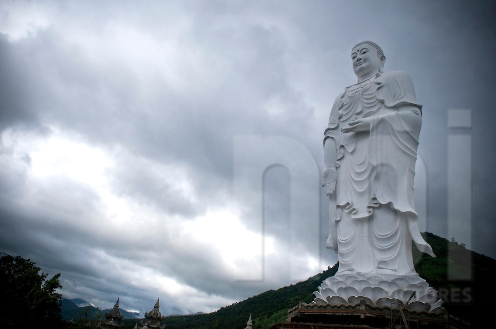Buddha statue in Khanh Hoa province, Vietnam, Asia. A dark heavy and dramatic sky complete the picture.