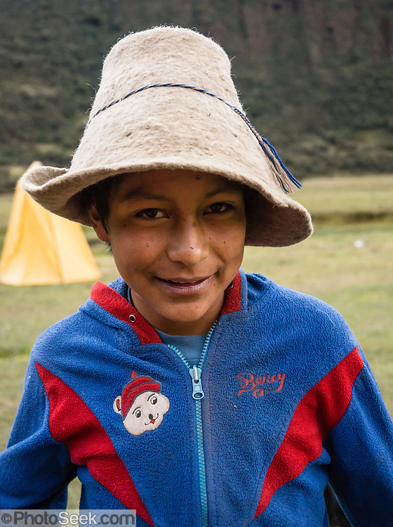 Campesino boy at Camp 4 at 3700 meters elevation in Jancapampa Valley, in the Cordillera Blanca, Andes Mountains, Peru, South America. Day 4 of 10 days trekking around Alpamayo in Huascaran National Park.