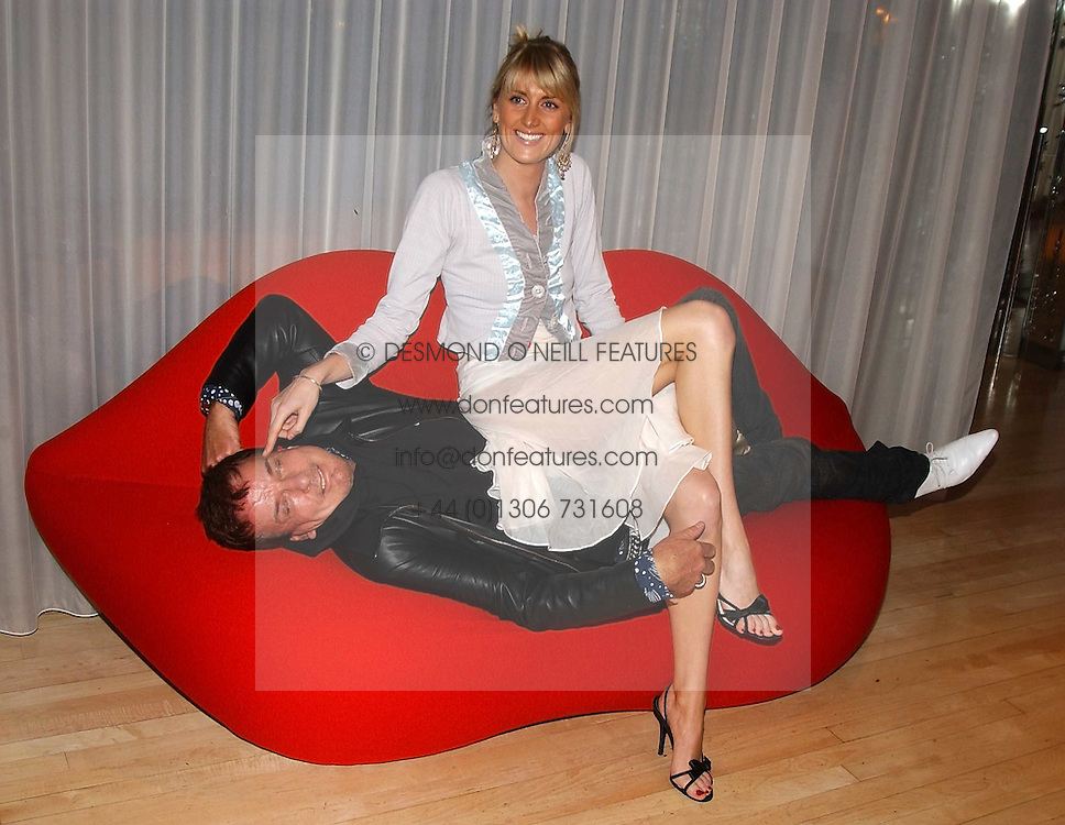 LADY EMILY COMPTON and NICKY HASLAM at the annual Laurent Perrier Pink Party held at The Sanderson Hotel, Berners Street, London on 27th April 2005.<br />