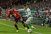Greg Taylor (#3) of Celtic wins the ball on the touchline  during the Europa League match between Celtic and Rennes at Celtic Park, Glasgow, Scotland on 28 November 2019.