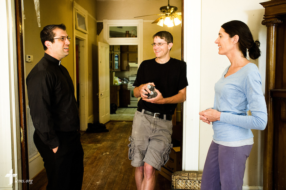 The Rev. Ross Johnson, director of LCMS Disaster Response, talks to Aaron Schneier and Pueschel Studstill Schneier in their home on Saturday, May 3, 2014, in Pensacola, Fla. The family's home suffered severe damage in the flooding. LCMS Communications/Erik M. Lunsford