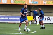 AFC Wimbledon midfielder Scott Wagstaff (7) warming up during the EFL Cup match between AFC Wimbledon and Milton Keynes Dons at the Cherry Red Records Stadium, Kingston, England on 13 August 2019.