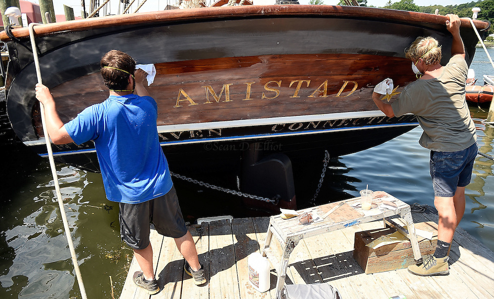 7/25/16 :: REGION :: STAND ALONE :: Joey Luketich and Sam Godfrey sand the transom of the schooner Amistad docked at Mystic Seaport Monday, July 25, 2016. The schooner is in the late stages of a comprehensive refit under the auspices of the new owner, Discovering Amistad, with new sails, rebuilt engines and extensive work on the hull and rigging. (Sean D. Elliot/The Day)