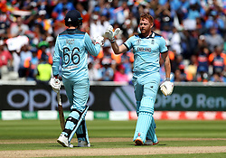 England's Jonny Bairstow celebrates reaching his century with team-mate Joe Root during the ICC Cricket World Cup group stage match at Edgbaston, Birmingham.