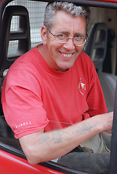 Portrait of builder sitting in truck smiling,