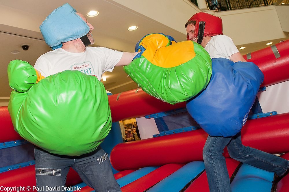 "Dr Rod Lawson Consultant in Respiratory Medicine at Sheffield Teaching Hospitals tries out the inflatable boxing ring at the launch of the ""Winning The Fight For Breath  with COPD Campaign"" in Meadowhall Shopping Centre Sheffield on Saturday 18th February 2012..www.pauldaviddrabble.co.uk..18th February 2012 -  Image © Paul David Drabble"