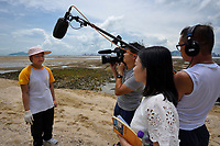 Secondary school student interviewed TV channel about the  release of juvenile horseshoe crabs that has been artificially-bred by City University of Hong Kong, and collectively releasing them into the wild after about six months. Chinese horseshoe crab, Tachypleus tridentatus, Ha Pak Nai is a wetland area, mud-bank in the Yuen Long District facing Deep Bay, New territories, Hong Kong, China. Horseshoe crabs are not crabs at all, but are most closely related to spiders, scorpions and trilobites. Tachypleus tridentatus is a species of horseshoe crab found in the seas off China, Indonesia, Japan, South Korea, Malaysia, the Philippines, Taiwan, and Vietnam. IUCN status is; data deficient.<br /> This Image is a part of the mission Wild Sea Hong Kong (Wild Wonders of China).