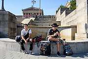 Philadelphia, Pennsylvania - September 17, 2015: When visiting Philadelphia, do as the tourists do: Eat a cheese steak at the foot of the Rocky Steps. Steven Rodriguez, left, and Miguel Rivera, eating the cheese steak, are friends who work on a cruise ship and are traveling during their paid leave.<br /> <br /> Scott Mirkin's company ESM is heading the production of The World Meeting Of Families and Pope Francis's visit to Philadelphia this Fall. The events will take place along the Benjamin Franklin Parkway.<br /> <br /> CREDIT: Matt Roth for The New York Times<br /> Assignment ID: 30179397A