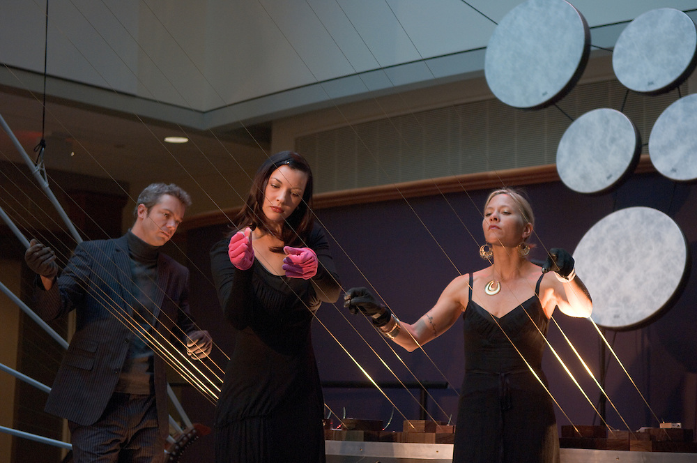 Baker Center Dedication.MASS Ensemble:..Mass (music Archeitecture, Sonic, Sculptue) Perform the EARTH HARPS? The world's Largest String instrument? The Center Atrium is transformed...Andrea Brook, Harpest (blonde hair), Chrysta Bell (black hair), Vocals, Rich Sherwood, drums, Cameron Morgan, Guitar, Bill Close, Art director(short hair)