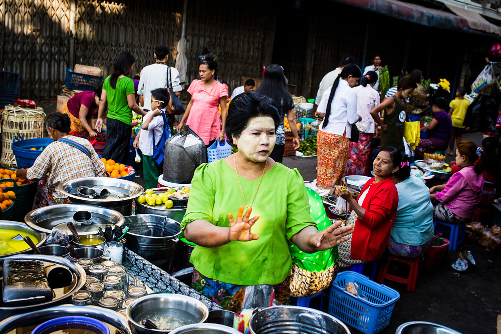 A street seller at her food stall in downtown Yangon, Myanmar.