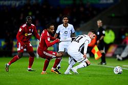 Kristoffer Peterson of Swansea City is challenged by Denis Odoi of Fulham - Mandatory by-line: Ryan Hiscott/JMP - 29/11/2019 - FOOTBALL - Liberty Stadium - Swansea, England - Swansea City v Fulham - Sky Bet Championship