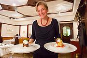 Bad St. Leonhard, Carinthia, Austria. Trippolts Zum Bären gourmet restaurant. The desserts.<br /> Flaumige Orangen-Buttermilch im Nougat-Karamell, Mandel-Krokant und Hollerblüten-Eis (l.), Zartes Biterschokolade-Törtchen mit frischen Erdbeeren.