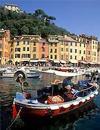 Colourful fishing boat in the harbour in<br /> Portofino, Liguria, Italy