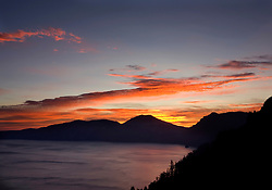 Fiery sunrise over the rim of Crater Lake, Crater Lake National Park, Oregon, United States of America