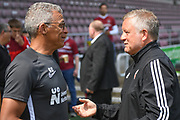 Sheffield United manager Chris Wilder  chats to Northampton Town manager Keith Curle during the Pre-Season Friendly match between Northampton Town and Sheffield United at the PTS Academy Stadium, Northampton, England on 20 July 2019.