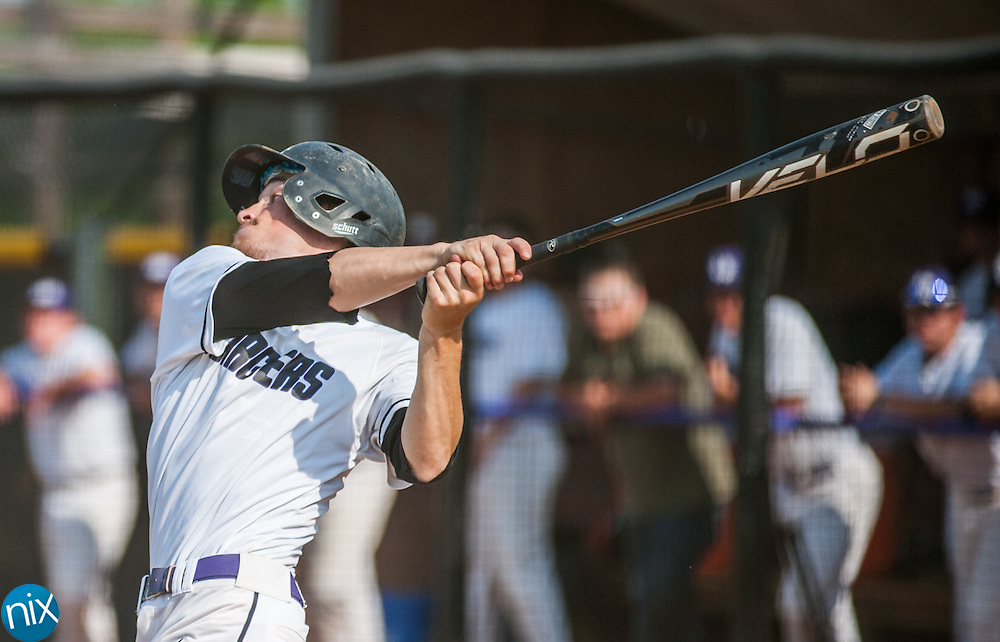 Cox Mill's Austin Fox (2) hits against East Rowan during the South Piedmont Conference Tournament at Cox Mill High School Wednesday afternoon. East Rowan won the game 1-0.
