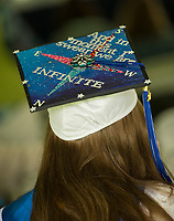 Individually decorated mortar boards adorned graduating seniors at the Inter-Lakes High School graduation Saturday morning in Prescott Park.  (Karen Bobotas/for the Laconia Daily Sun)