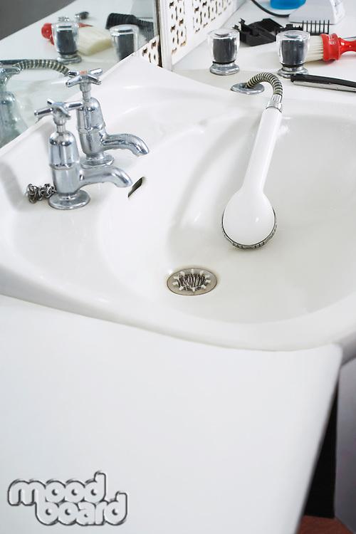 Shower head in sink at barber shop