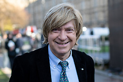 © Licensed to London News Pictures. 13/12/2018. London, UK. Michael Fabricant MP speaking in College Green. Yesterday, British Prime Minister Theresa May won the backing of her party to stay on as Prime Minister, following a vote of no confidence, after she postponed the vote on her EU withdrawal deal. Photo credit : Tom Nicholson/LNP