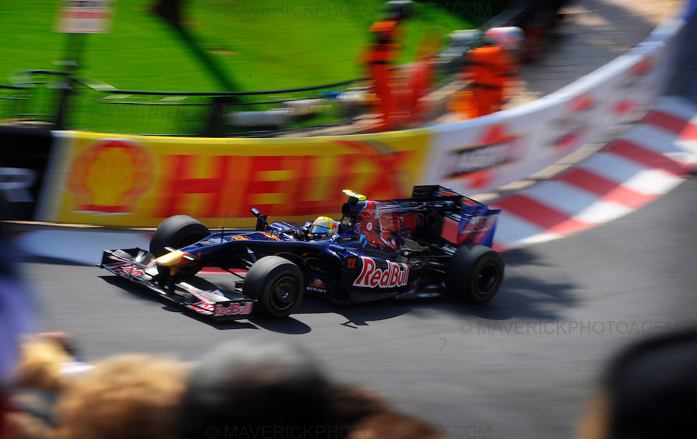 Cars pound around the streets of Monte Carlo during Thursday practice ahead of this weekends Monaco Grand Prix.  Pictured Torro Rosso driver Sebastien Buemi makes his way around the Casino Square section of the circuit.