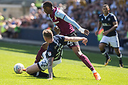 Millwall Aiden O'Brien (22) tackles Aston Villa Jonathan Kodjia (22) during the EFL Sky Bet Championship match between Millwall and Aston Villa at The Den, London, England on 6 May 2018. Picture by Robin Pope.