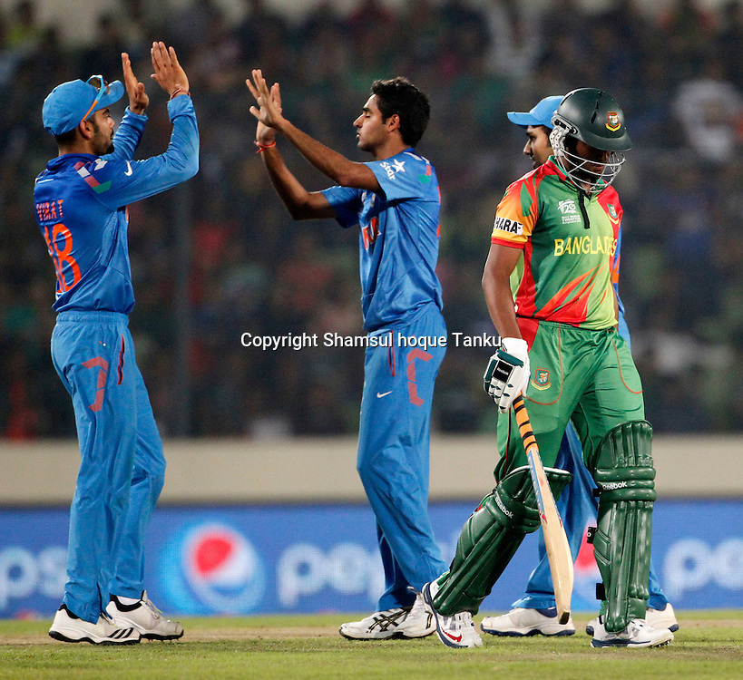 India celebrates wicket of Shakib Al Hasan - Bangladesh v India - ICC World Twenty20, Bangladesh 2014. 29 March 2014, Sher-e-Bangla National Cricket Stadium, Mirpur. Photo: Shamsul hoque Tanku/www.photosport.co.nz