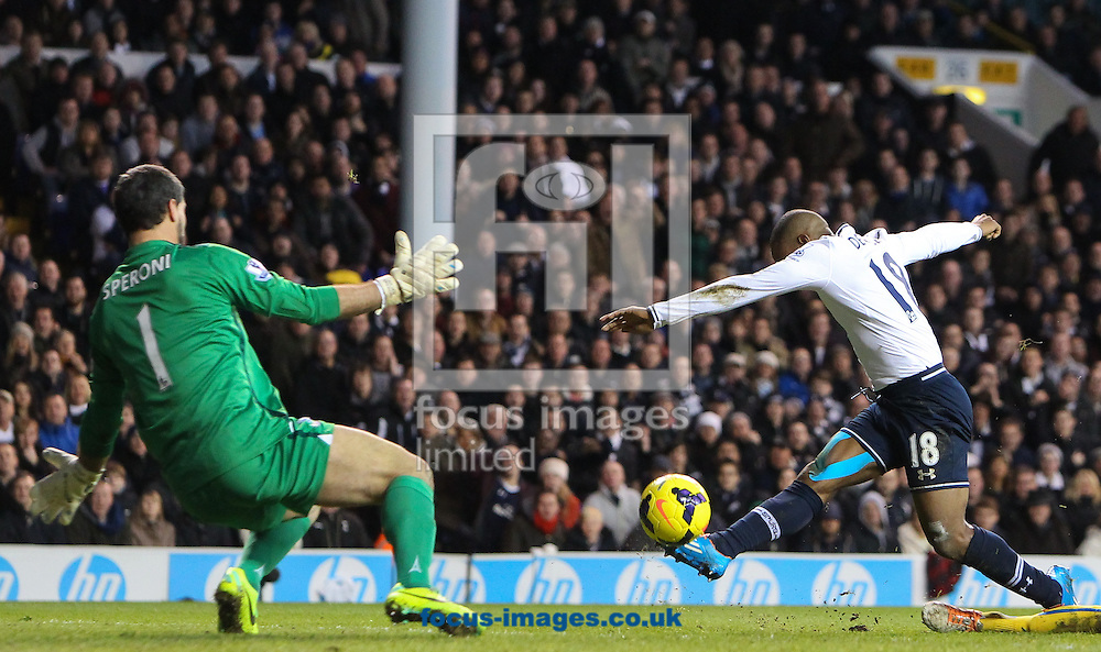 Picture by John Rainford/Focus Images Ltd +44 7506 538356<br /> 11/01/2014<br /> Jermaine Defoe of Tottenham Hotspur fires the ball past Julian Speroni of Crystal Palace during the Barclays Premier League match at White Hart Lane, London.