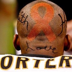 October 3, 2010; New Orleans, LA, USA; New Orleans Saints cornerback Tracy Porter (22) is seen with a cancer ribbon painted on his head during a game against the Carolina Panthers at the Louisiana Superdome.  The NFL is supporting breast cancer awareness month with a pink initiative where players will wear pink equipment throughout the month of October. Mandatory Credit: Derick E. Hingle