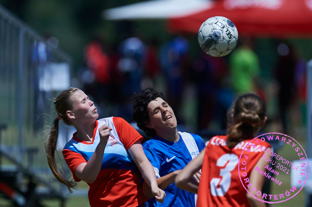 SO Russia athlete (C) fights for the ball with SO Greece athlete (L) while football women match 7-a-side during fourth day of the Special Olympics World Games Los Angeles 2015 on July 28, 2015 at Balboa Sports Centre in Los Angeles, USA.<br /> USA, Los Angeles, July 28, 2015<br /> <br /> Picture also available in RAW (NEF) or TIFF format on special request.<br /> <br /> For editorial use only. Any commercial or promotional use requires permission.<br /> <br /> Adam Nurkiewicz declares that he has no rights to the image of people at the photographs of his authorship.<br /> <br /> Mandatory credit:<br /> Photo by &copy; Adam Nurkiewicz / Mediasport