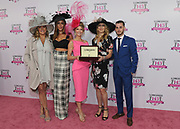 Tennis legend and Longines Ambassador of Elegance Stefanie Graf, second right, presents Krista Rosenberg, center, of Boca Raton, FL, with a Longines DolceVita timepiece following her win of the Longines Kentucky Oaks Day Fashion Contest, Friday, May 5, 2017, in Louisville, KY. Longines, the Swiss watch manufacturer known for its luxury timepieces, is the Official Watch and Timekeeper of the 143rd annual Kentucky Derby. (Photo by Diane Bondareff/AP Images for Longines)