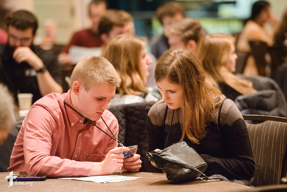 Attendees at the Liberty National LCMS Campus Ministry Conference review schedules on Wednesday, Jan. 4, 2017, at the University of Maryland in College Park, Md. LCMS Communications/Erik M. Lunsford