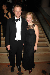 MARIELLA FROSTRUP and her husband JASON McCUE at The Diner Des Tsars in aid of Unicef to celebrate the launch of Quintessentially Wine held at the Guildhall, London EC2 on 29th March 2007.<br />
