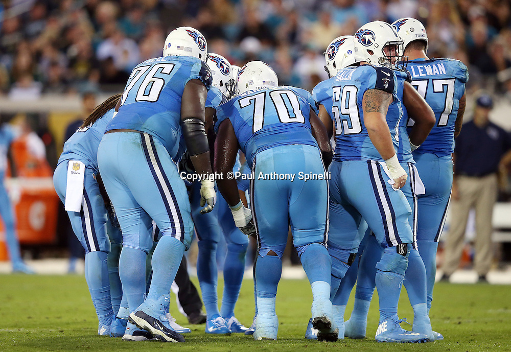 The Tennessee Titans offense huddles and calls a play during the 2015 week 11 regular season NFL football game against the Jacksonville Jaguars on Thursday, Nov. 19, 2015 in Jacksonville, Fla. The Jaguars won the game 19-13. (©Paul Anthony Spinelli)