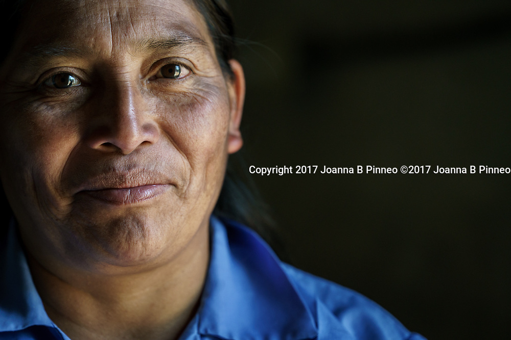Bernada Mendez, age 48, is from the Lenca people of southwestern Honduras. <br /> She received a new improved stove she received a year ago from participating in the Honduran Cookstove Study by Colorado State University. Since she has been using the new stove she reports that she does not suffer from the chronic headaches and burning watery eyes she has for the last 20 years. She also reports using a fourth as much wood for cooking as she did cooking on a traditional stove. Bernarda is using a Justa stove designed by Trees, Water, People and Apececho Research Center.
