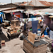 A compound in Agbogbloshie, a slum in Ghana's capital, Accra. Traditionally, a single extended family would have lived here. Today, individual rooms and dwellings are more typically rented by tenants.