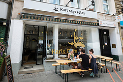 Modern cafe called Karl's Cafe on Karl Marx Strasse (Street) in Neukolln district in Berlin Germany