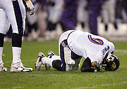 DENVER - OCTOBER 9:  Quarterback Steve McNair #9 of the Baltimore Ravens on the ground after a big hit by the Denver Broncos at INVESCO Field at Mile High on October 9, 2006 in Denver, Colorado. The Broncos defeated the Ravens 13-3. ©Paul Anthony Spinelli *** Local Caption *** Steve McNair