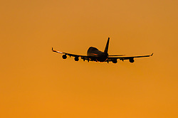 A British Airways Boeing 747-400 takes off into the sunset from London's Heathrow Airport (LHR / EGLL).