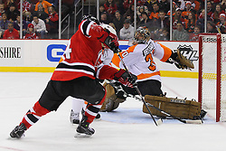 Jan 21; Newark, NJ, USA; Philadelphia Flyers goalie Ilya Bryzgalov (30) makes a pad save on New Jersey Devils center Adam Henrique (14) during the first period at the Prudential Center.