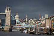 Thames barges are moored in front of St. Paul's Cathedral, the Monument and Tower Bridge in the distance, on 17th January 2020, in London, England.