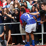 Alatasi Tupou climbs up to the fans, on Manu's farewell lap, for a photo on the third and final day of action at the USA Sevens, Sam Boyd Stadium, Las Vegas, Nevada.  Photo by Barry Markowitz, Courtesy STP/TriMarine, 1/26/14, 4pm
