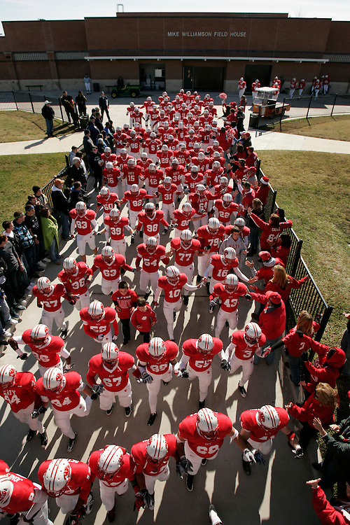 The Katy Tigers make their way onto the field to face the Clear Springs Chargers before the 5A Region III championship, Saturday, December 9, 2009 at Tully Stadium in Houston, TX.