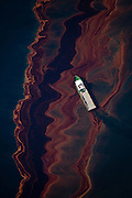 Louisiana (USA). May 6th, 2010. Aerial view of the oil leaked from the Deepwater Horizon wellhead,  the BP leased oil platform exploded April 20 and sank after burning. The picture was taken in the vicinity where the platform sank from an altitude of 3200 ft. Photo by Daniel Beltra/Greenpeace